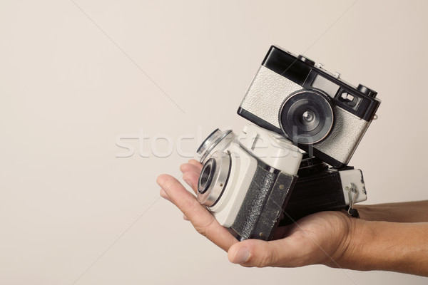 young man with old film cameras Stock photo © nito