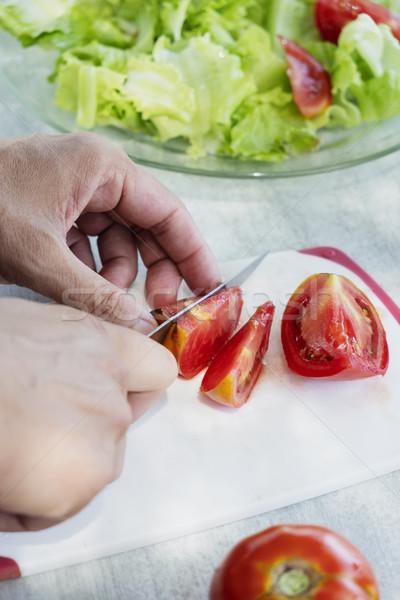 young man preparing a green salad Stock photo © nito