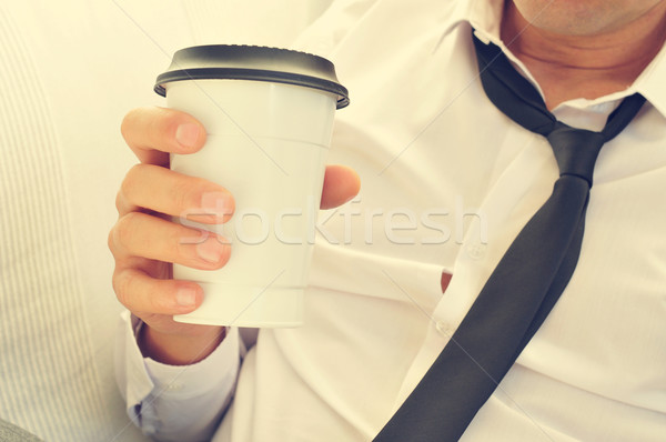 young man drinking coffee in a paper cup Stock photo © nito
