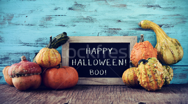 pumpkins and chalkboard with text happy halloween Stock photo © nito