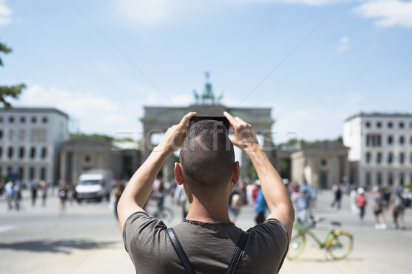 young man taking a picture of the Brandenburg Gate Stock photo © nito
