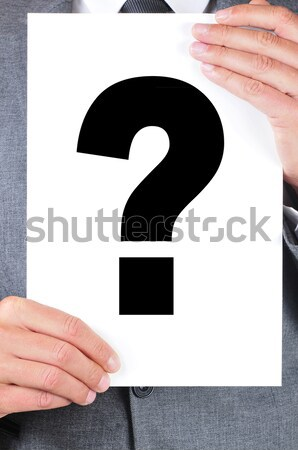 man in suit holding a signboard with a question mark on it Stock photo © nito