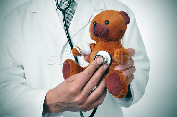 Arts teddybeer hoofd arm geneeskunde veeartsenijkundig Stockfoto © nito