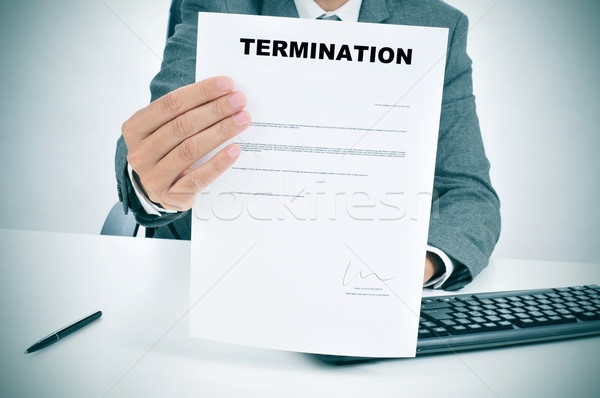 man in suit showing a figured signed termination document Stock photo © nito