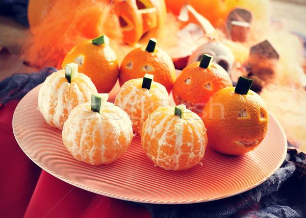 mandarines ornamented as Halloween pumpkins Stock photo © nito