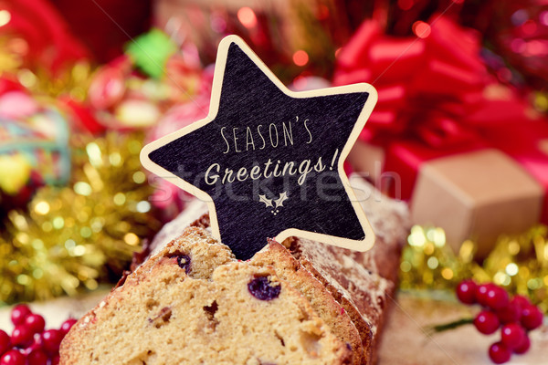 fruitcake topped with a chalkboard with the text seasons greetin Stock photo © nito