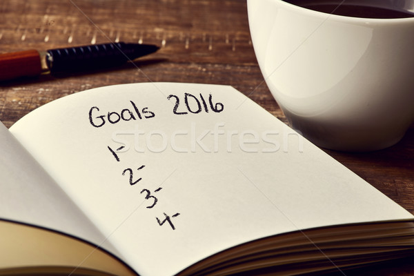 coffee and notepad with a blank list of goals for 2016 Stock photo © nito