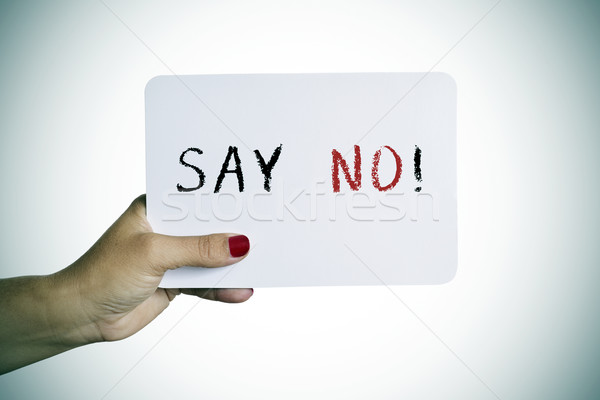 woman holding a signboard with the text say no Stock photo © nito