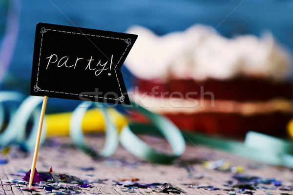 confetti, streamers, cake and signboard with word party Stock photo © nito