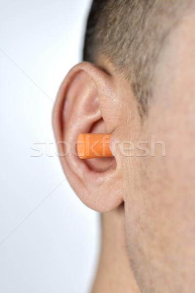 man with an earplug in his ear Stock photo © nito