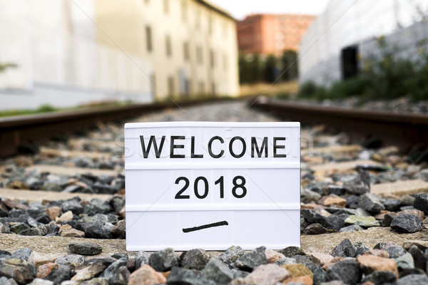 Stock photo: text welcome 2018 in a lightbox on the railway