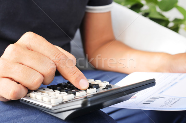 young man checking a bill, a budget or a payroll Stock photo © nito