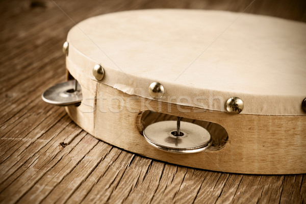 tambourine on a rustic wooden table, retro look Stock photo © nito