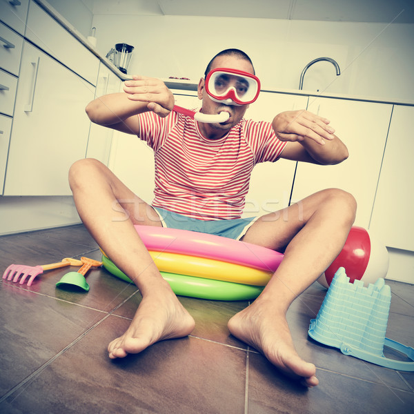 man swimming in an inflatable water pool, indoors, with a dramat Stock photo © nito