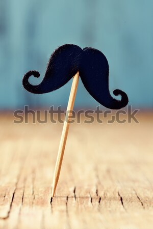 felt mustaches in sticks on a wooden surface Stock photo © nito