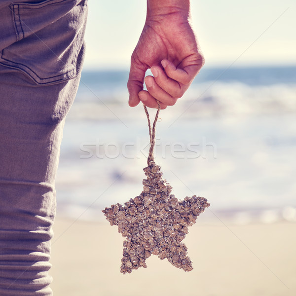 young man with a christmas star on the beach, filtered Stock photo © nito