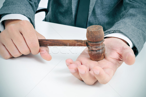 Stock photo: man with a gavel in his hand