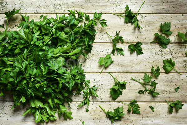 buncho of parsley on a rustic white table Stock photo © nito