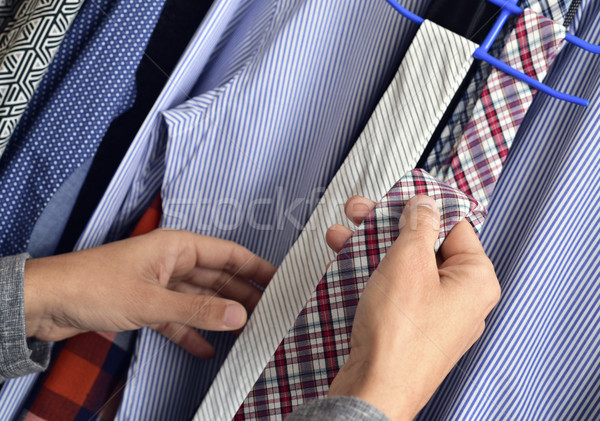young man choosing a tie from the closet Stock photo © nito