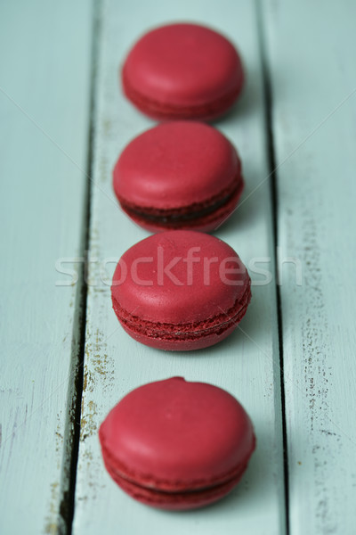 red macarons on a blue rustic table Stock photo © nito