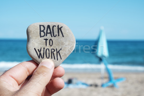 Stock photo: folded beach umbrella and text back to work