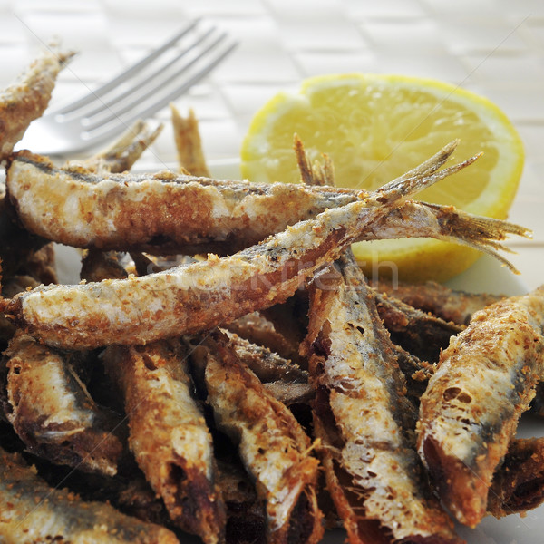 spanish boquerones fritos, fried anchovies typical in Spain Stock photo © nito