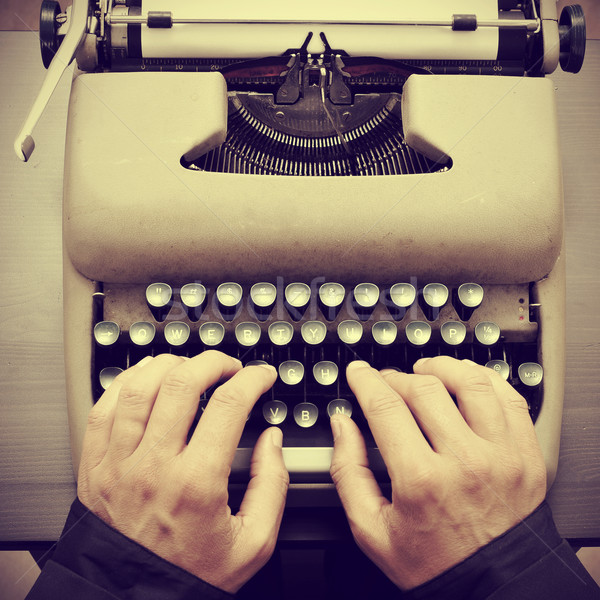 man typing on an old typewriter, with a retro effect Stock photo © nito