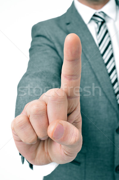 businessman holding up his index finger Stock photo © nito