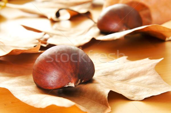 őszi levelek fa asztal gyümölcs ősz eszik édes Stock fotó © nito