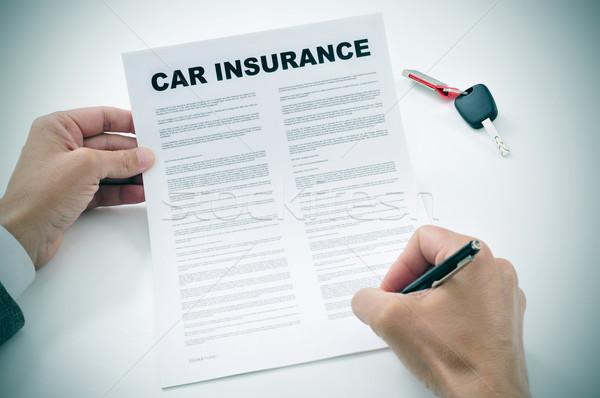 Férfi aláírás autó biztosítás irányvonal közelkép Stock fotó © nito