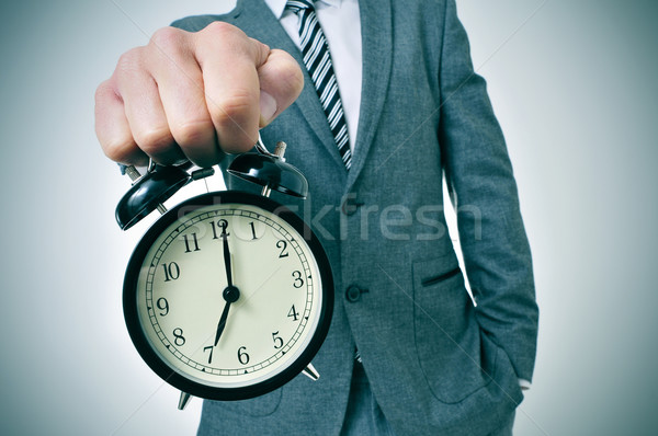 young man with an alarm clock Stock photo © nito