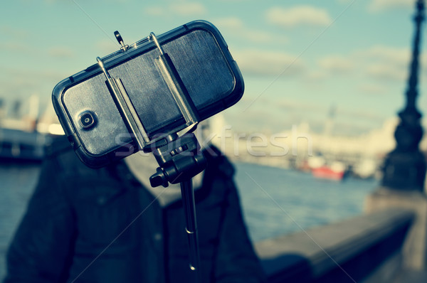 man taking a selfie next to the River Thames in London, with a f Stock photo © nito