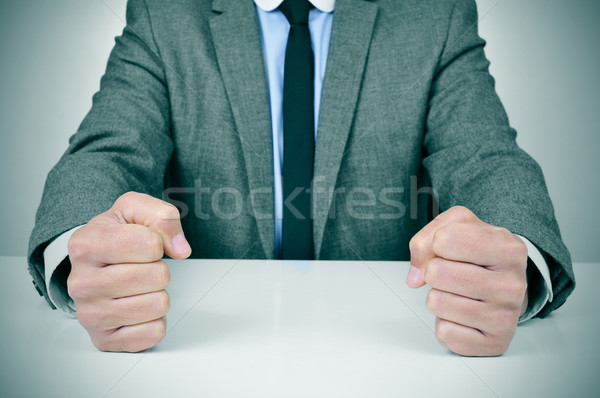 man in suit banging his fists on a desk Stock photo © nito