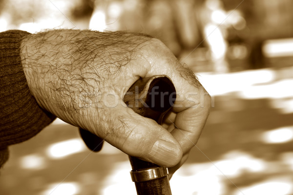 old man with a walking stick, in sepia toning Stock photo © nito