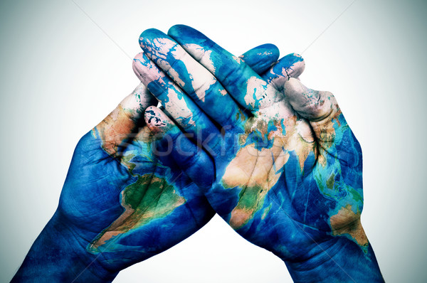 man hands patterned with a world map (furnished by NASA) Stock photo © nito