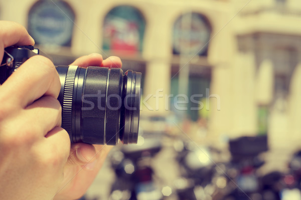 man taking a picture in the street, with a filter effect Stock photo © nito