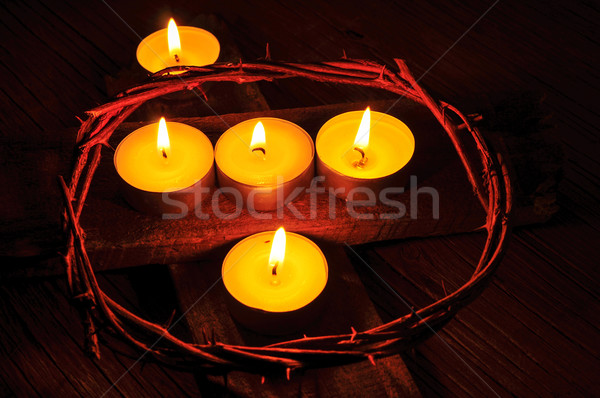 a crown of thorns and some lit candles on a wooden cross Stock photo © nito