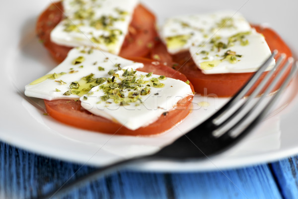 tomato and cheese, dressed with olive oil and oregano Stock photo © nito