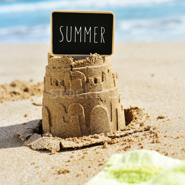 text summer in a signboard topping a sandcastle Stock photo © nito