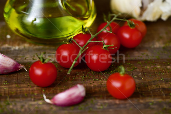 olive oil, tomatoes and garlic on a wooden table Stock photo © nito