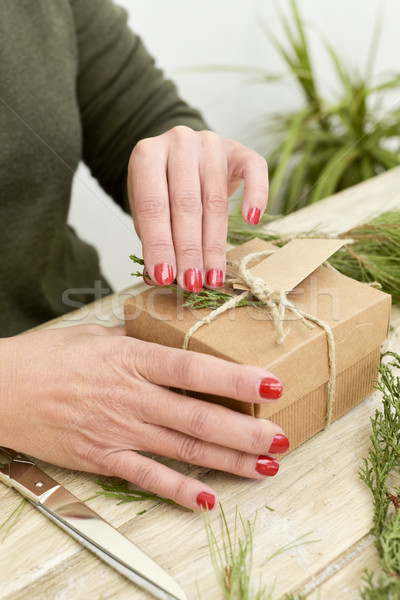 woman tying a string around a gift Stock photo © nito