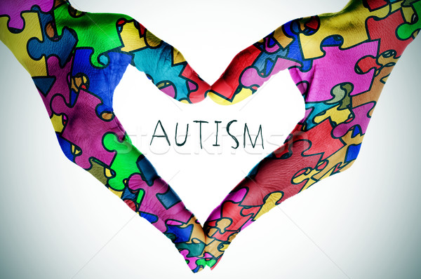 Texto autismo mãos coração peças do puzzle mulher Foto stock © nito