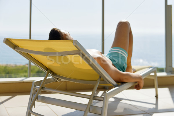 young man sun tanning in a sunlounger Stock photo © nito