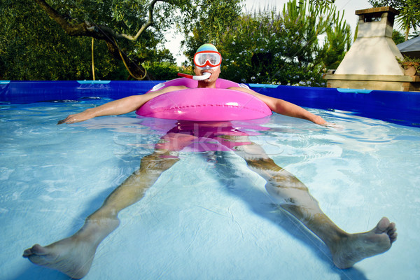 man swimming in a portable swimming pool Stock photo © nito