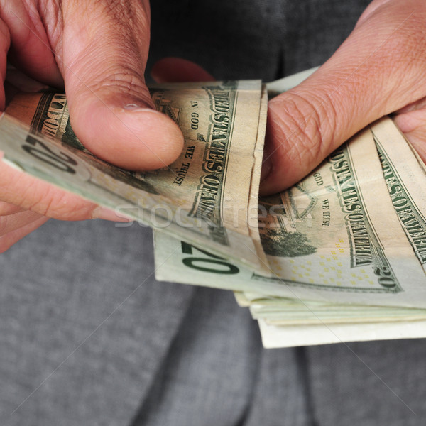 man in suit with counting dollar bills Stock photo © nito