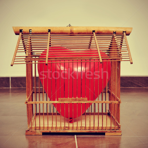 heart-shaped balloon in an old birdcage, with a retro effect Stock photo © nito