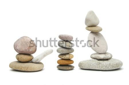 Kiegyensúlyozott zen kövek köteg fehér virág Stock fotó © nito