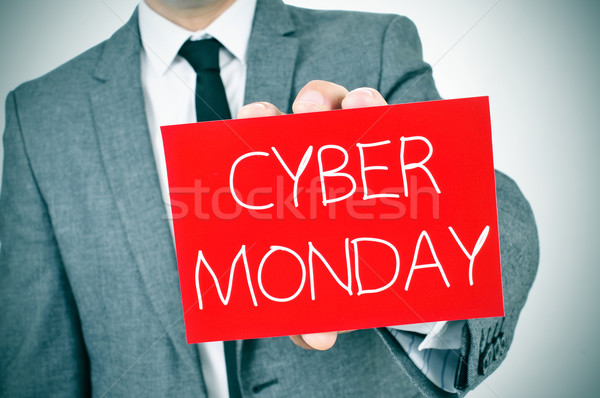 man in suit with a signboard with the text cyber monday Stock photo © nito