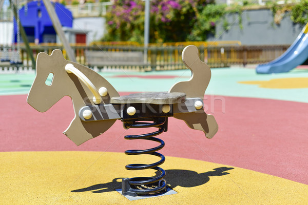 spring rider in a playground Stock photo © nito