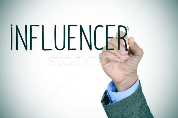 man writing the word influencer Stock photo © nito